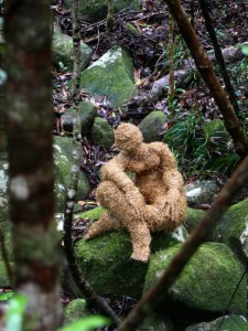 straw figure in rainforest