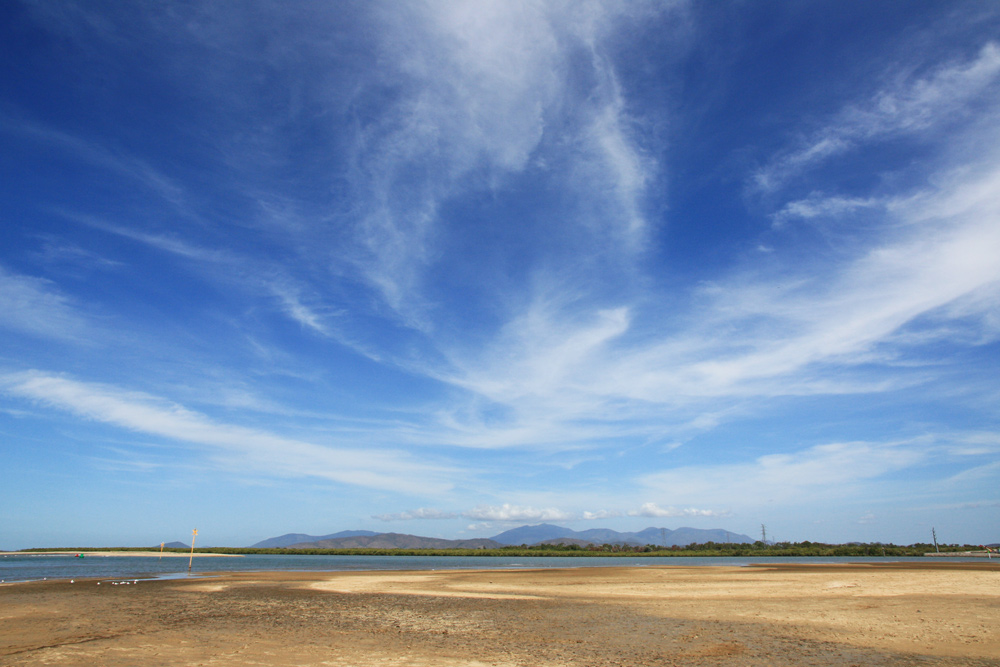 high cloud over beach at Ross River estuary