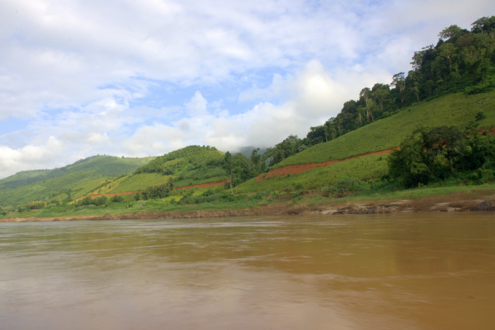 new road by the river, with cleared hillsides