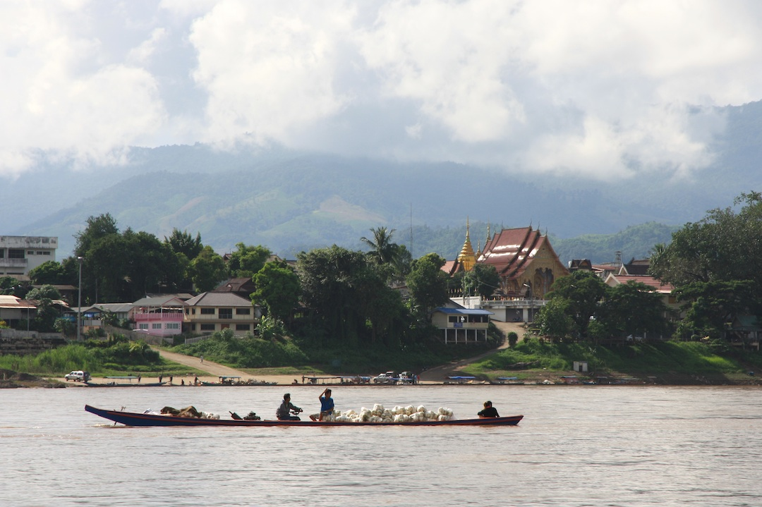 small canoe with passengers and cargo