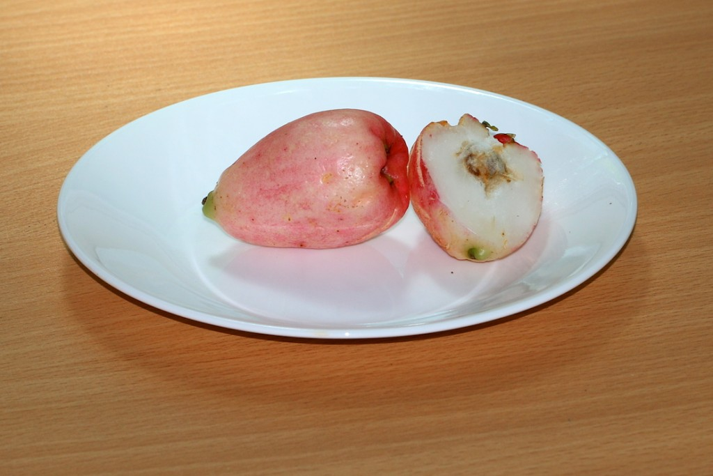 pink fruit on plate