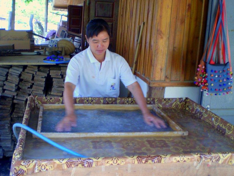 paper maker washing a fabric screen