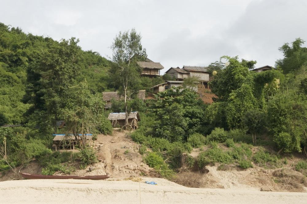 village on high sandy river bank
