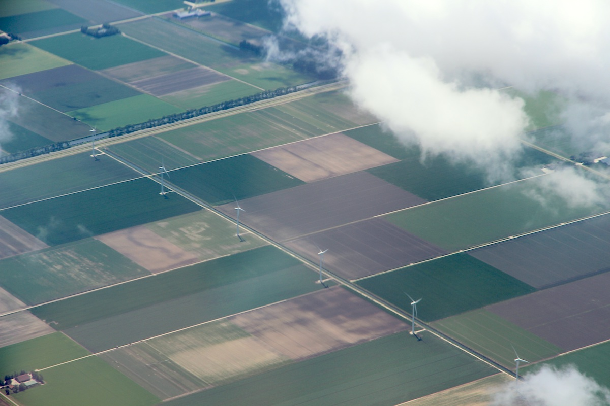Wind power in Holland: a neat row of windmills along the canal as far as possible from the neat rows of farmhouses