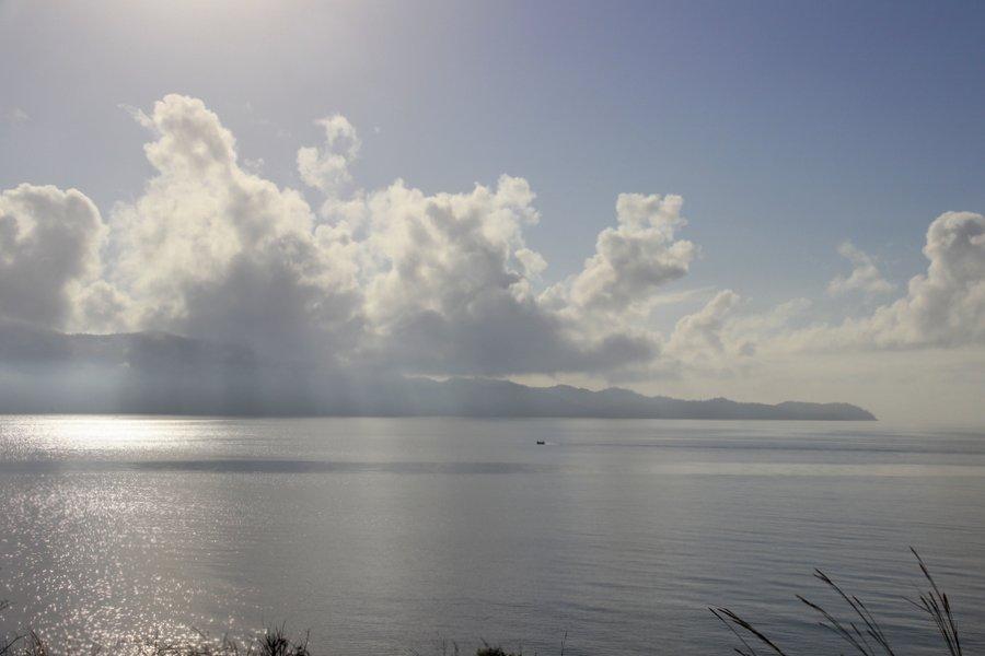 Island under backlit clouds
